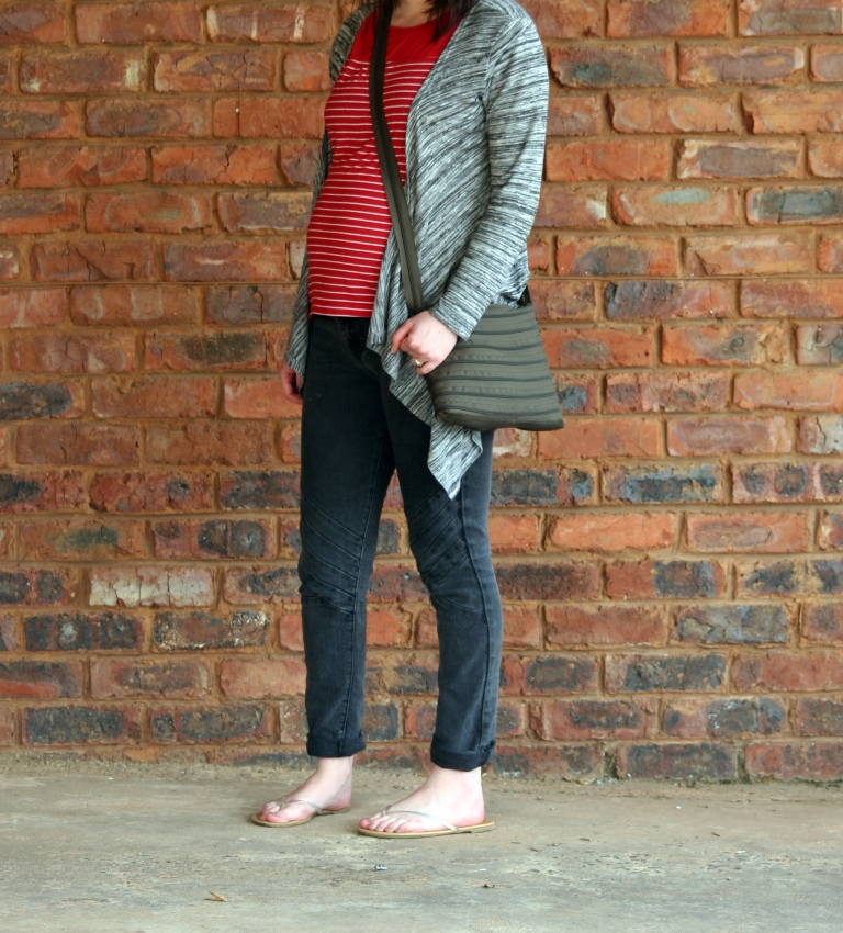 red tee, grey cardigan, charcoal jeans