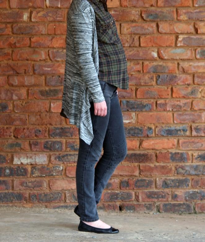 green tartan shirt, grey cardigan, charcoal jeans