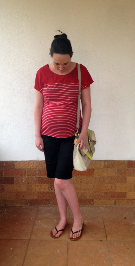 Red and white striped tee, black shorts, maternity outfit