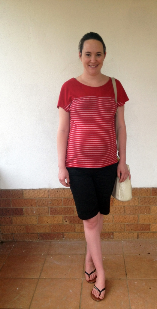 Red tee, black shorts, maternity outfit